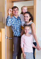 first-time home buyer middle class family in new house
