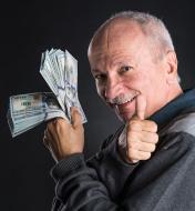 happy-elderly-man-showing-dollars