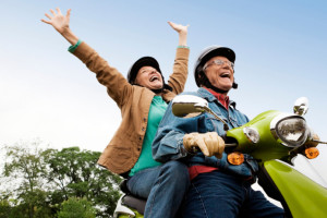 Senior Couple Riding Scooter